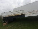Single axle with drop side.